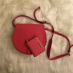 Rebecca Minkoff Skylar Large Cute and fun bag! Color is pink just as second pic. Looks red due to lighting. Please see scratch in third pic by my finger (hardly visible when looking. I bought bag like this cause I didn't notice it) and some small stains in back of bag. Can send more pic on request. Condition of outside B+ and inside A. Comes with dust bag and matching wallet. Silver hardware on bag but gold hardware on wallet. Rebecca Minkoff Bags