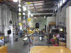 The Corradetti Glassblowing Studio and Galley, fashioned from a turn-of-the-last-century foundry in Baltimore, schedules individuals and groups for glassblowing lessons.