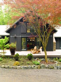 Pole Barn House Plans and Prices Exterior Farmhouse with Adirondack Chairs Barn Door Brown Dark Deck