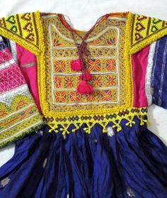 beaded Afghan dress for child   - Explore the World with Travel Nerd Nici, one Country at a Time. http://TravelNerdNici.com