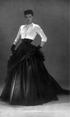 https://flic.kr/p/o84YsU   Wearing an evening gown by Christian Dior, photo by Georges Saad, 1952