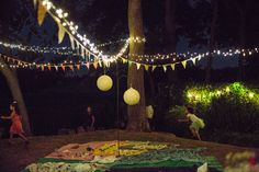 First Birthday Party Celebration on the lawn... Bunting with twinkle lights and a colorful array of picnic blankets made for a magical evening!