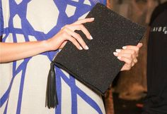 Bibhu Mohapatra clutch and white nails