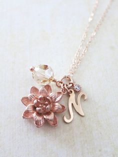Simple rose gold lotus blossom, Swarovski golden shadow crystal beads (10mm), rose gold filled initial and a cubic zirconia drop come on a rose gold filled 17 inch chain. What a pretty and beautiful way to share love and joy with your loved ones. Perfect personalized gift for your sisters, best friends and loved ones.    Easy to stack with other necklaces and goes with everything in your wardrobe.    ✦ Rose Gold lotus: 0.5 inch  ✦ Chain: Rose gold Filled  ✦ Length: Please choose from the…