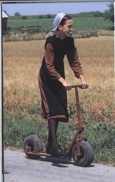 Amish girl with scooter by Catacami, via Flickr