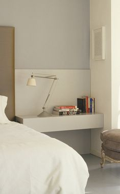 Double the Function This substantial shelf floats above the ground at just the right height to double as a desk.