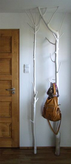 Painted tree branches for coat hanger