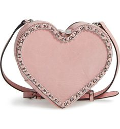Chain-link trim traces the heart-shaped silhouette of this compact Rebecca Minkoff crossbody that sweetly energizes the street style.