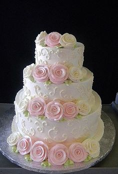 sweet three tier wedding cake with roses                                                                                                                                                                                 More