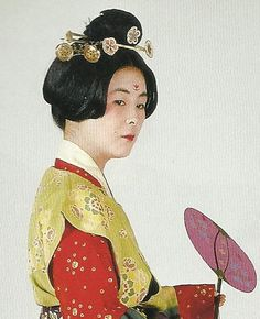 """Scan O1: Court lady of the Nara Period (710-784) , Japan. Textiles during this period of Japan were often brocade ones heavily influenced by China (and in some cases the cloth itself was directly imported from that country) . Scan from book """"The History of Women's Costume in Japan."""" Scanned by Lumikettu of Flickr. Japanese costume many centuries ago…recreation accomplished in Kyoto during the 1930's.."""