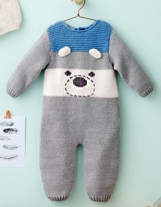 Free Knitting Pattern for Teddy Bear Romper - Baby onesie with embroidered bear face. Sizesa) newborn – b) 3 – c) 6 – d) 12 mths Designed by Phildar. DK weight.