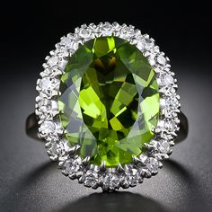 We at Gemone Diamond offer certified 7.98 Ct Natural peridot ring 14k gold with SI clarity at an affordable price. Buy without hesitation.
