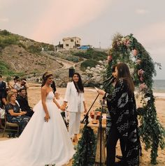 Wed in a beautiful cove in Sitges, near Barcelona, Aida Domenech (aka Spanish blogger Dulceida) went princess-perfect in a strapless dress with a v dramatic XXL train, while Alba chose the chicest ever white suit. Musician Shinoflow officiated the ceremony (incred) in an ASOS slim-fit suit, cooly layered with a knitted cape