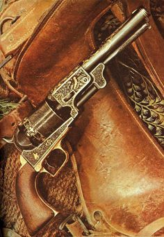 Colt Dragoon cap and ball revolver, heavily engraved and inlayed.