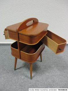 Danish sewing box, designer not credited. I like the way that it's a piece of furniture but also has a handle for moving from room to room