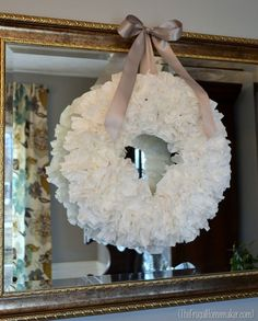 Coffee Filter Wreath...who knew!  If someone wanted color...could try using colored chalk on ends and blend it in.  Could also glue on things like snowflakes, or butterflies, or whatever season its for.