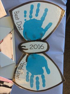 Father's Day gift-bow tie handprint art with clothespin glued to the back. We had the dads wear these at our Donuts with Dad event.
