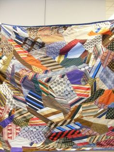 This crazy 'necktie' quilt is from the collection of Wanita Kueter. Wanita's mother, Doris Skeie, pieced and quilted the necktie quilt from silk ties gathered from Wanita's uncle and from garage sales. It was given to Wanita as a gift.