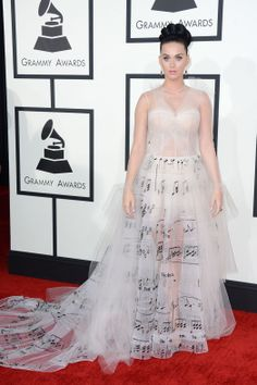 Pop superstar Katy Perry, who is set to perform and is nominated for two Grammy awards, is certainly angling for the best-dressed awards with this white Valentino dress printed with music notes.