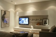Built in cupboards around the tv