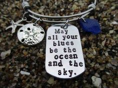 """""""May all your Blues be the Ocean and the Sky."""" bracelet with starfish, sand dollar and beautiful blue sea glass❤️. Find it in the shop below ⬇️  •  www.lobstermanswife.etsy.com  •  #Lobstermanswife #Etsy #etsyseller #ocean #beach #beachlife #bracelet #starfish #sanddollar #sea #seaglass #nautical #quote #blue #jewelry #colorful #coast #coastal #charms #darkblue"""
