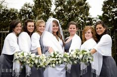 Grey bridesmaid dresses, white flowers with pine, white pashmina shawls... even snow on the trees! Perfect for our winter wedding.
