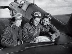 """USSR, WWII. Called by the Germans the """"Night Witches"""" (women military aviators of the 588th Night Bomber Regiment, known later as the 46th """"Taman"""" Guards Night Bomber Aviation Regiment, of the Soviet Air Forces). Lidya Litvyak, Katya Budanova and Masha Kuznetsova, Stalingrad, autumn1942. The female aviators fought to defend the city, besieged by the Germans."""