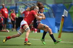 Britain's Abbie Brown (R) is tackled by Canada's Karen Paquin in the womens rugby sevens match between Canada and Britain during the Rio 2016 Olympic Games at Deodoro Stadium in Rio de Janeiro on August 7, 2016. / AFP / Pascal GUYOT