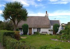 Old thatched cottage on the road to Point of Ayre Lighthouse through the village of Kirk Bride