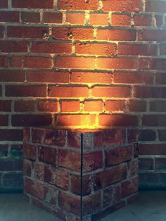 Brick covers used to camouflage lighting equipment.  Also availing in black, white, tan, mottled ivory and green turf.