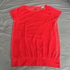 . Nike dri fit short sleeve top. Really comfy bright and fun work out top!! Back has a cute detail see last 2 pictures.  Also available in black in medium. Ask for listing of intetested Nike Tops