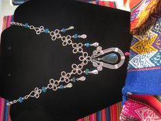 Turquoise Colored stones. Pretty loopy links on this one! $18