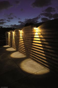 When designing your backyard, don't forget to carefully plan your lighting as well. Get great ideas for your backyard oasis here with our landscape lighting design ideas. Outside Lighting Ideas, Fence Lighting, Backyard Lighting, Outdoor Wall Lighting, Exterior Lighting, Diy Fence, Backyard Fences, Wooden Fence, Backyard Landscaping