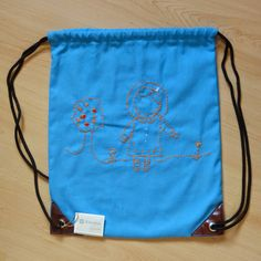 Mochila de tela bordada con dibujos infantiles