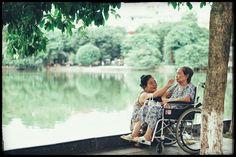 Vietnam Streetlife Photography: Carer by Thuy Dang www.emporiumhanoi.com #Hanoi #Vietnam #lake #photo #photography #travel