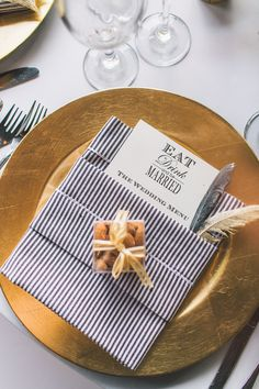 Black and white striped napkin on a pretty gold charger #decor Photography: Anna Delores Photography - www.annadelores.com Read More: http://www.stylemepretty.com/2014/08/20/elegant-modern-california-ranch-wedding/