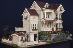 Fantastic front view of dollhouse with wonderful landscaping and exterior details.  Beautiful <3