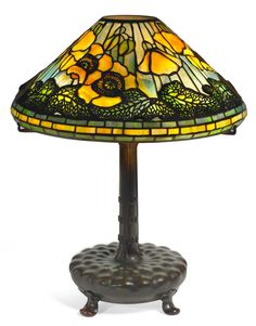 Art Glass:Tiffany , TIFFANY STUDIOS POPPY TABLE LAMP. Bronze lamp base withyellow and green leaded glass shade in a poppy motif, ci... Image...