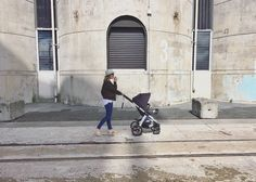 The concrete jungle, cosmopolitan stroller and one superbly styled Mama