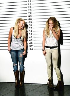 Miranda Lambert (left) and Carrie Underwood laugh on the set of their video shoot for 'Something Bad' on May 20, 2014, in Nashville.