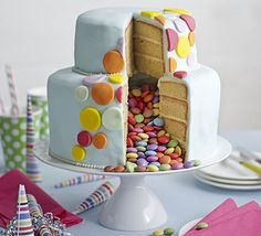 Celebration piñata cake. Bake this stunning centrepiece for kids' birthdays or parties - cut open the vanilla and lemon sponges to reveal the hidden sweets inside
