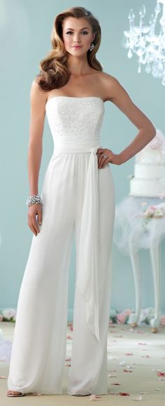 This strapless chiffon jumpsuit features a semi-sweetheart hand-beaded bodice, wrap around multi-layer chiffon belt at natural waist and wide leg pants.