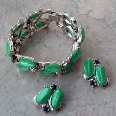 1960s vintage bracelet with matching clip on earrings set in a green and purple color Each in this costume jewellery set has the same green thermoplastic stones