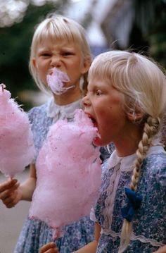 Girls eat large swirls of cotton candy in Copenhagen, Denmark, January 1963. Photograph by Gilbert M. Grosvenor.