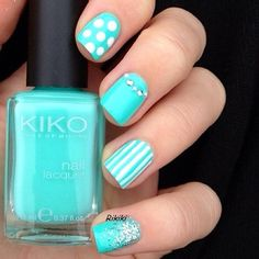The only time polka dots and strips go together is in nails like these.