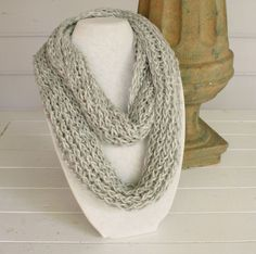 A beautiful gray infinity scarf with a shine throughout the yarn.  Hand knitted and fits all sizes. by TrinksKnitting on Etsy