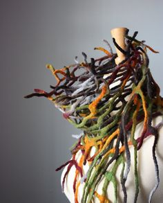 Made of felt!  I love this really sculptural look to this scarf.  I really count it as jewelry instead!