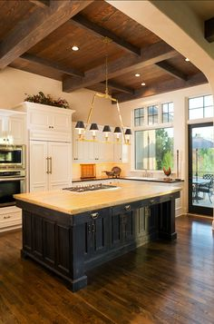 Kitchen. French Kitchen. French kitchen with rustic reclaimed beam ceiling and large island. Love!