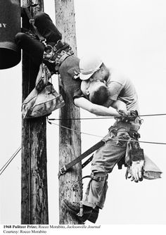 1968:The Kiss of Life, Electric lineman resuscitates injured colleague in Jacksonville, Fla., July 17, 1967, by Rocco Morabito, Jacksonville Journal. Credit: Rocco Morabito
