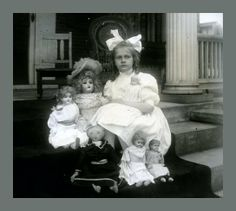 Exceptional c. 1900 Photo of Young Girl with Many Bisque, Tin and Cloth Dolls
